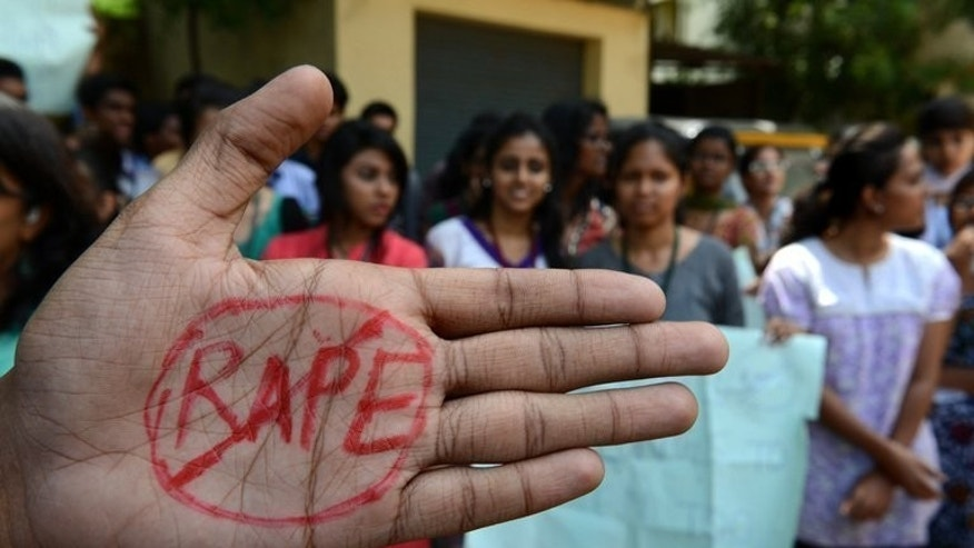 Indian students of Saint Joseph Degree college take part in an anti-rape protest in Hyderabad on September 13, 2013. Four men condemned to death for the murder and gang-rape of an Indian student have been brought back to court as their lawyers confirmed before judges that they would appeal the sentences.