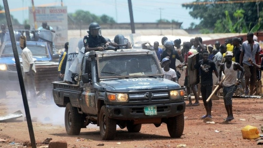 A Guinean police vehicle patrols as protesters clash with the police on September 23, 2013 in Conakry.