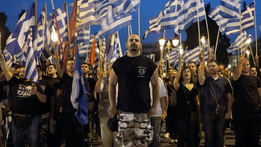 Members and supporters of the ultra-nationalist Golden Dawn party rally in central Athens. Greek police have raided the offices of neo-Nazi party Golden Dawn and arrested a police officer, authorities said, amid a major probe on the links between law enforcers and far-right politicians.