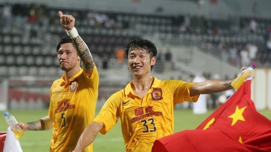 China's Guangzhou Evergrande players celebrate after their AFC Champions League match against Qatar's Lekhwiya in Doha on September 18, 2013.