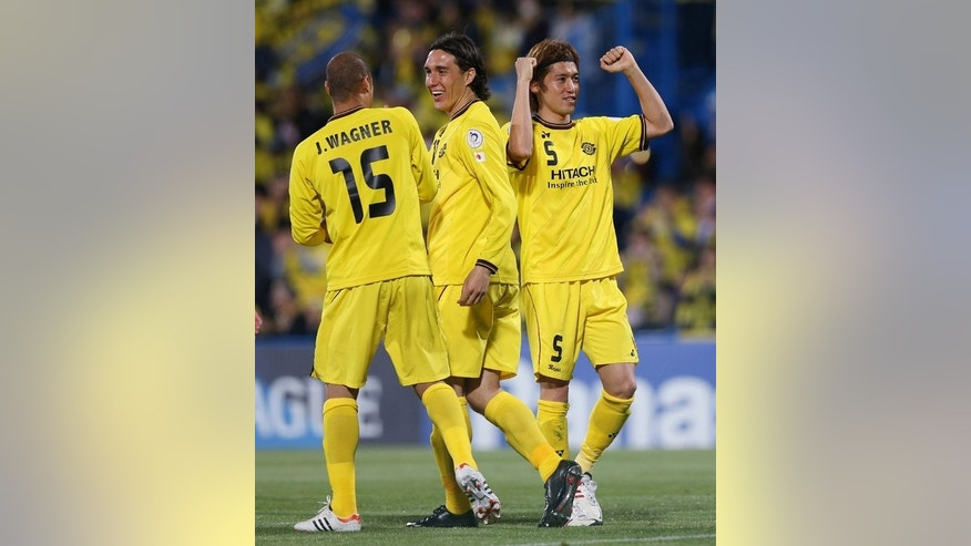Kashiwa Reysol defender Tatsuya Masushima (R) celebrates after scoring during an AFC Champions League match against Guizhou Renhe in Japan on April 23, 2013.