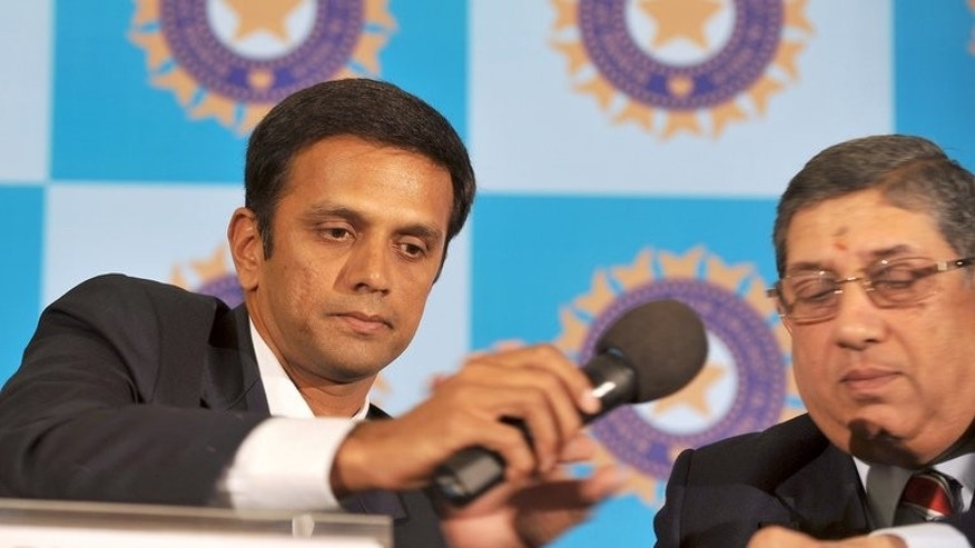 Indian cricketer Rahul Dravid (left) hands a microphone to Board of Control for Cricket in India President Narayanaswami Srinivasan at a press conference in Bangalore on March 9, 2012. India's powerful cricket chief Srinivasan faces a last-minute legal challenge to his attempted return to the top job following a betting scandal that has rocked the sport, a lawyer said Tuesday.