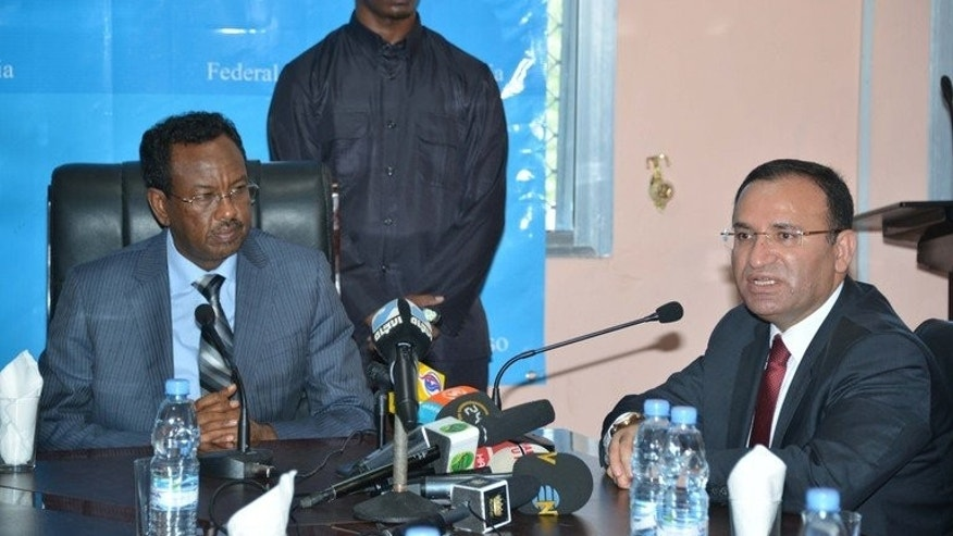 Somali Prime Minister Abdi Farah Shirdon (left) and Turkish deputy prime minister Bekir Bozdag at the presidential palace in Mogadishu, on February 23, 2013. Farah Shirdon on Tuesday said those behind Nairobi's ongoing mall siege, which has left at least 65 dead and has been claimed by Somalia's Al-Qaeda-linked Shebab militants, must be brought to justice.