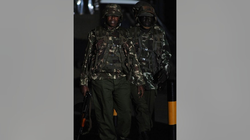 Kenyan paramilitary soldiers walk towards the Westgate mall on September 24, 2013 in Nairobi.