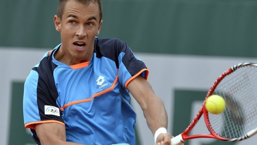 Czech Republic's Lukas Rosol returns to Italy's Fabio Fognini during their French Tennis Open second round match in Paris on May 30, 2013. Eighth seeded Rosol smashed 16 aces as he continued an upturn in form with a three-set win over Poland's Lukasz Kubot at the Thailand Open on Tuesday.
