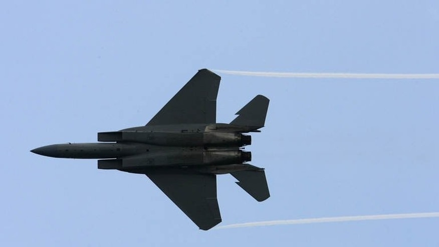 File picture shows an F-15 Eagle fighter jet during an airshow display at the Asian Aerospace 2006 exhibition in Singapore on February 21, 2006.