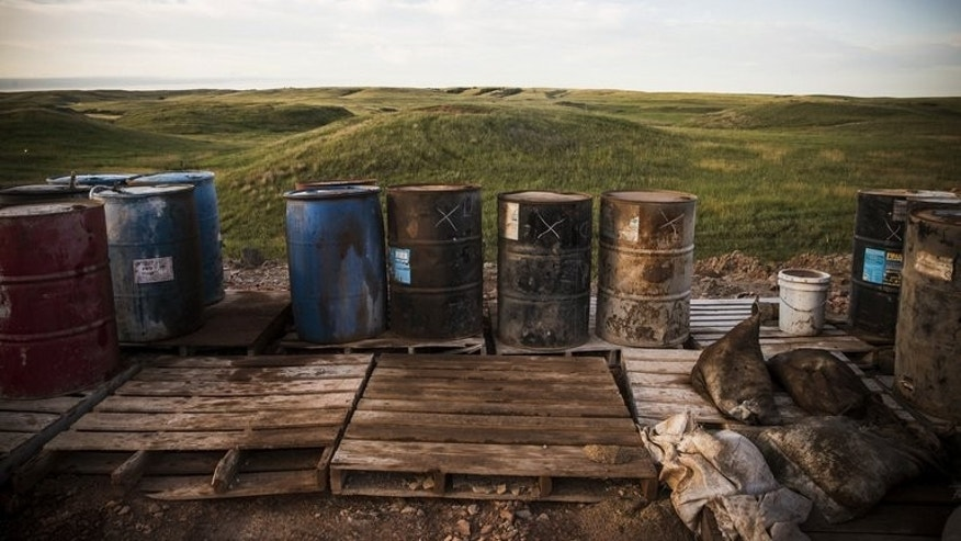 Barrels and pallets sit on the site of an oil derrick in the Bakken shale formation on July 23, 2013 outside Watford City, North Dakota.