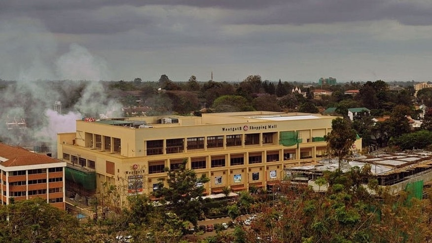 Smoke rises from the Westgate mall on September 24, 2013 in Nairobi.
