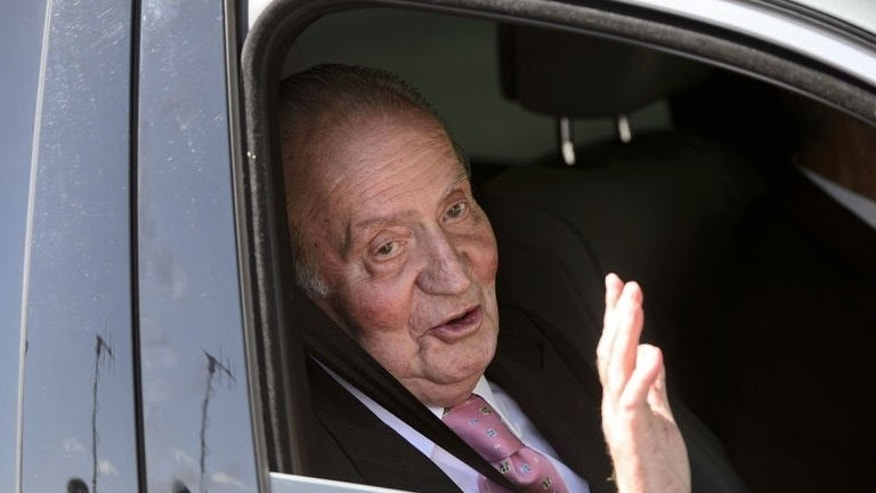 Spain's King Juan Carlos arrives to the Quiron University Hospital in Madrid on September 24, 2013. The king is to have his left hip operated on for the eighth time since 2010 announced the royal palace.