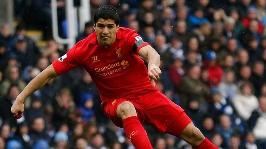 Liverpool striker Luis Suarez shoots during a Premier League match against Reading at The Madejski Stadium in Reading, southern England on April 13, 2013.