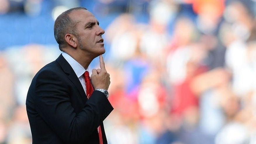 Sunderland manager Paolo Di Canio reacts towards the Sunderland fans at The Hawthorns in West Bromwich, central England, on September 21, 2013.