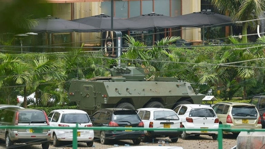 "A Kenyan army tank drives in front of Westgate Mall on September 23 in Nairobi. Kenyan special forces are still battling ""one or two"" Islamist militants holed up inside the mall, security sources say."