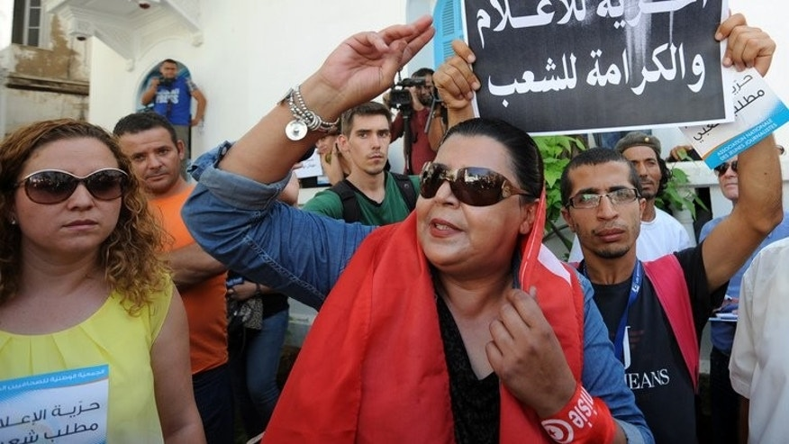 Tunisian journalists take part in a sit-in organized by journalists in Tunis on September 17, 2013. A Tunisian court on Tuesday freed on bail a film director detained last month for throwing an egg at the culture minister, one of his lawyers told AFP.