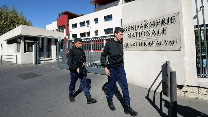 French gendarmes walk, on September 24, 2013 in Marseille, in front of the entrance of the Beauvau Gendarmerie barracks.