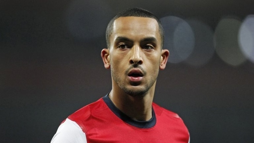 Arsenal's English striker Theo Walcott looks on during the English FA Cup third round replay between Arsenal and Swansea City at the Emirates Stadium in London on January 16, 2013.