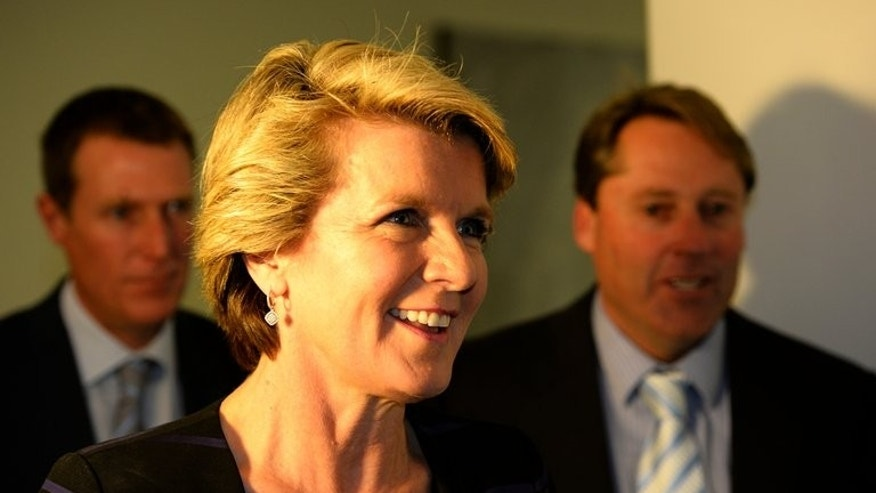 Australian Foreign Minister Julie Bishop leaves in Parliament House in Canberra, on September 13, 2013