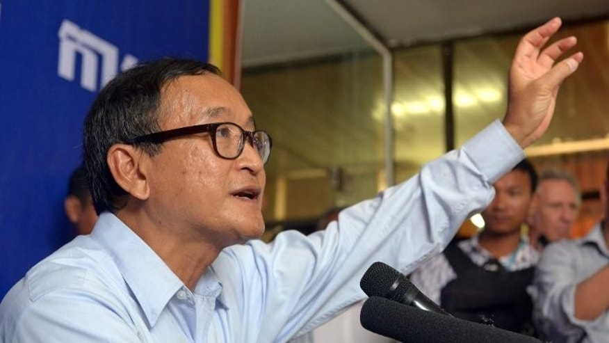 Cambodia National Rescue Party (CNRP)leader Sam Rainsy speaks to the media during a press conference in Phnom Penh, on September 25, 2013.