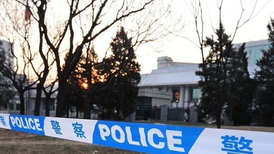 Chinese police cordon off a courthouse in Beijing on December 23, 2009