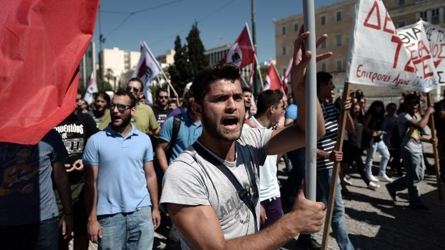 Greek parties, unions and students gather outside the Parliament in Athens during an anti-racism protest on September 25, 2013.