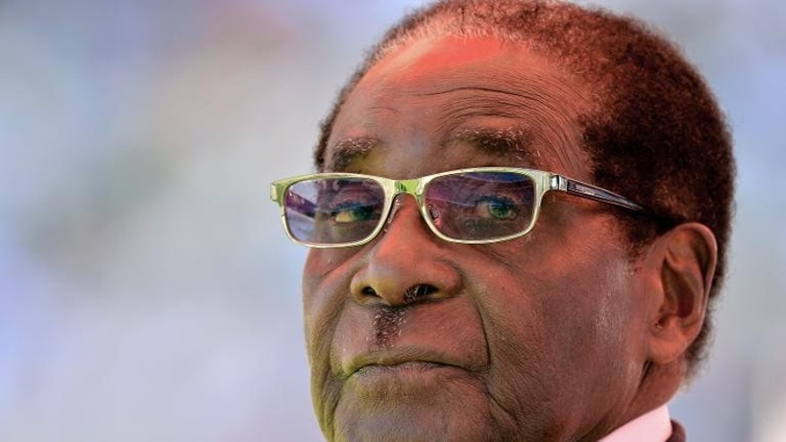 Zimbabwean President Robert Mugabe looks on during his inauguration on August 22, 2013 in Harare.