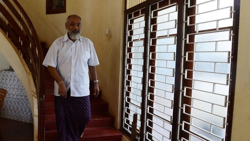 Sri Lanka's Tamil National Alliance (TNA) leader C. V. Wigneswaran is seen before speaking to reporters in Jaffna, on September 22, 2013.