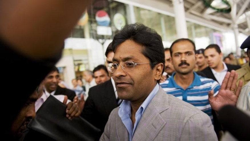 Suspended Indian Premier League (IPL) Chairman Lalit Modi (C) is seen at Indira Gandhi International Airport in New Delhi on April 28, 2010