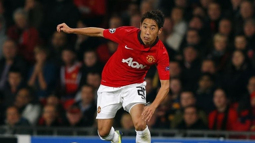 Manchester United's Japanese midfielder Shinji Kagawa, seen at Old Trafford on September 17, 2013. Kagawa still has progress to make before he can stake a claim for a regular first-team place at Manchester United, according to manager David Moyes.