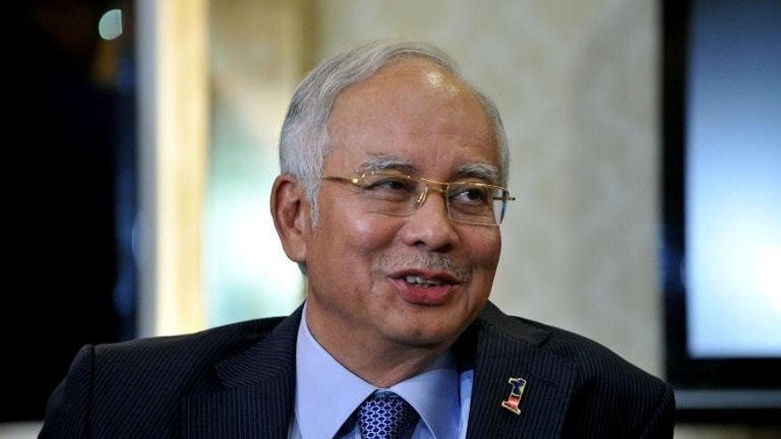 Malaysia's Prime Minister Najib Razak smiles as he speaks during a press conference in Kuala Lumpur on May 7, 2013.