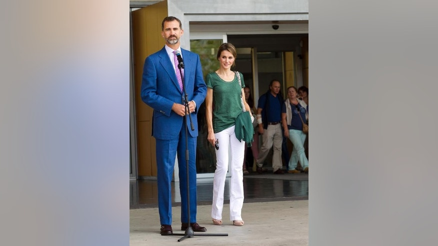Prince of Asturia's Felipe of Spain (L) and Princess Letizia (R) leave Quiron University Hospital in Madrid on September 25, 2013, where Spain's 75-year-old King Juan Carlos recovers after hip-replacement surgery.