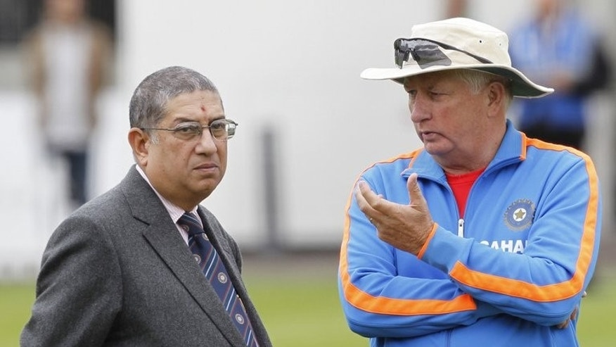 Narayanaswami Srinivasan, the president of the BCCI, talks to India coach Duncan Fletcher during a training session at Lord's Cricket Ground in London on July 20, 2011.
