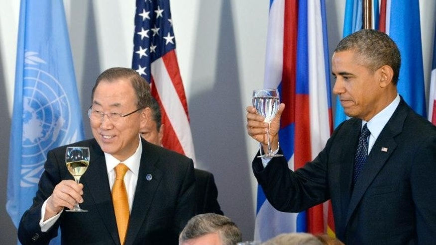 US President Barack Obama toasts with UN Secretary General Ban Ki-Moon at the UN General Assembly in New York on September 24, 2013.