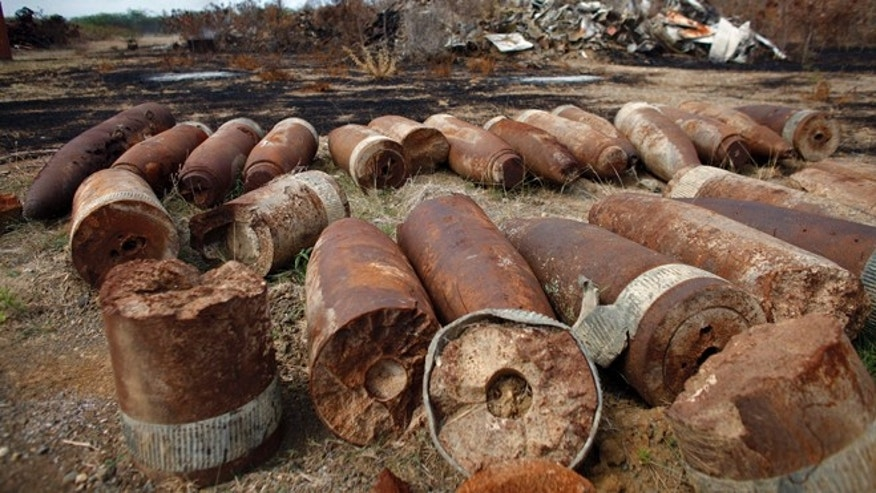 Disabled and non-live artillery and mortar shells sit piled on what was once the U.S. Naval training range on Vieques Island off Puerto Rico.
