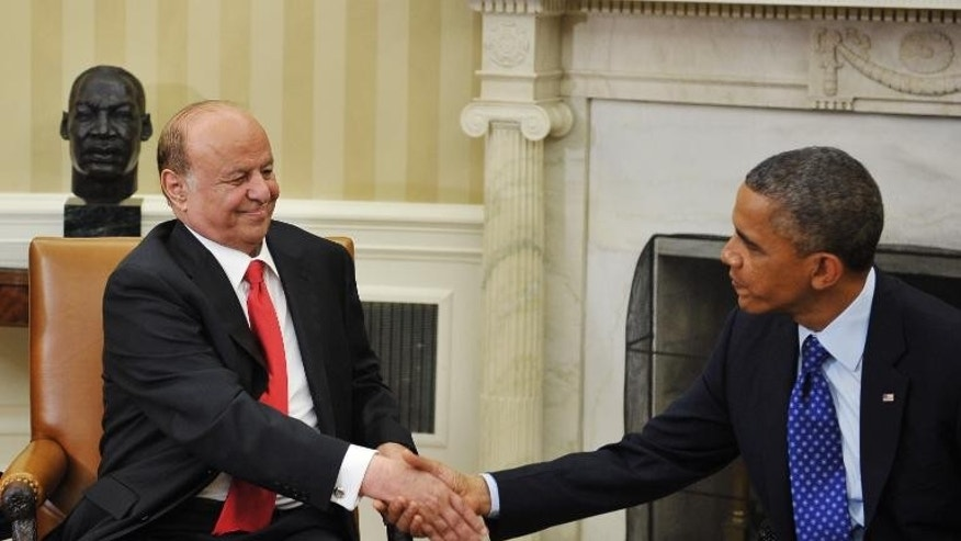 US President Barack Obama shakes hands with Yemen's President Abdrabuh Mansur Hadi during a meeting at the White House on August 1, 2013 in Washington, DC.