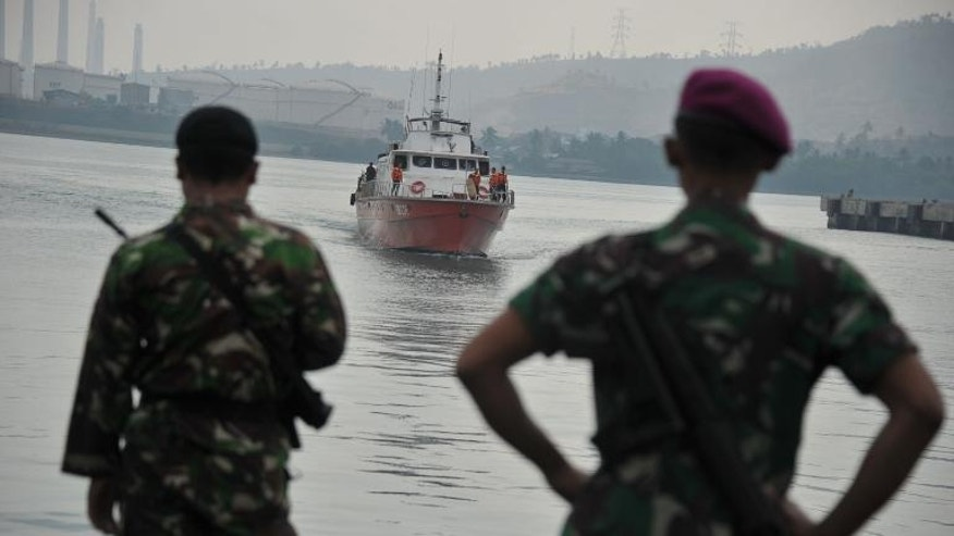 "File photo shows Indonesian marines watching a rescue boat carrying asylum-seekers at Merak seaport. Australian Prime Minister Tony Abbott has described asylum-boats arriving from Indonesia as a ""passing irritant"" to the relationship with Jakarta."