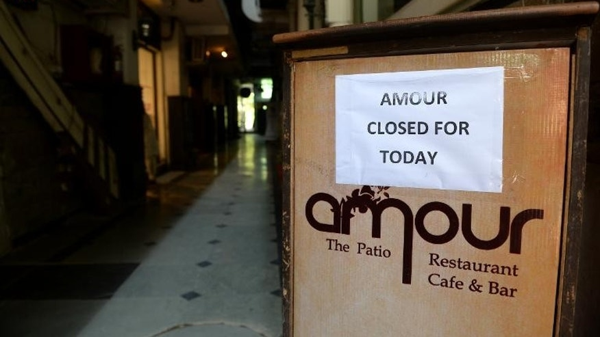 A closure notice is posted on a podium at an Indian restaurant at Hauz Khas Village in New Delhi, September 23, 2013.