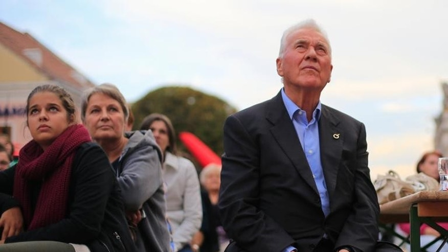 Businessman and politician Frank Stronach (R), listens to a speech during an election campaign event of the Team Stronach party in Eisenstadt on September 11, 2013