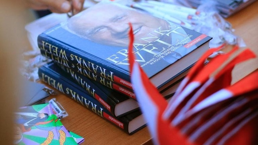 "Copies of the book ""Frank's World"", by Canadian businessman and politician Frank Stronach, are seen during an election campaign event of the Team Stronach party in Eisenstadt on September 11, 2013"