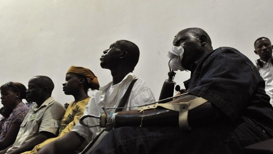 A victim watches the trial of Liberian ex-leader Charles Taylor in the Hague on April 26, 2012.