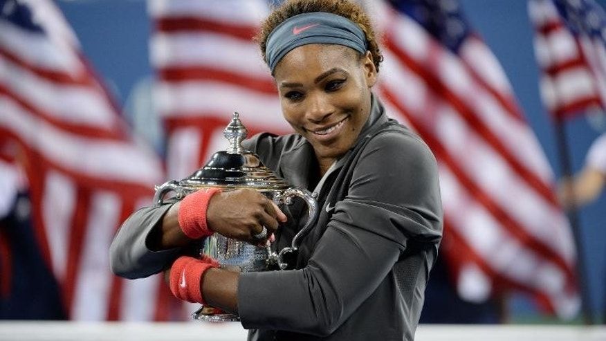 Serena Williams celebrates her win over Victoria Azarenka at the US Open in New York on September 8, 2013.