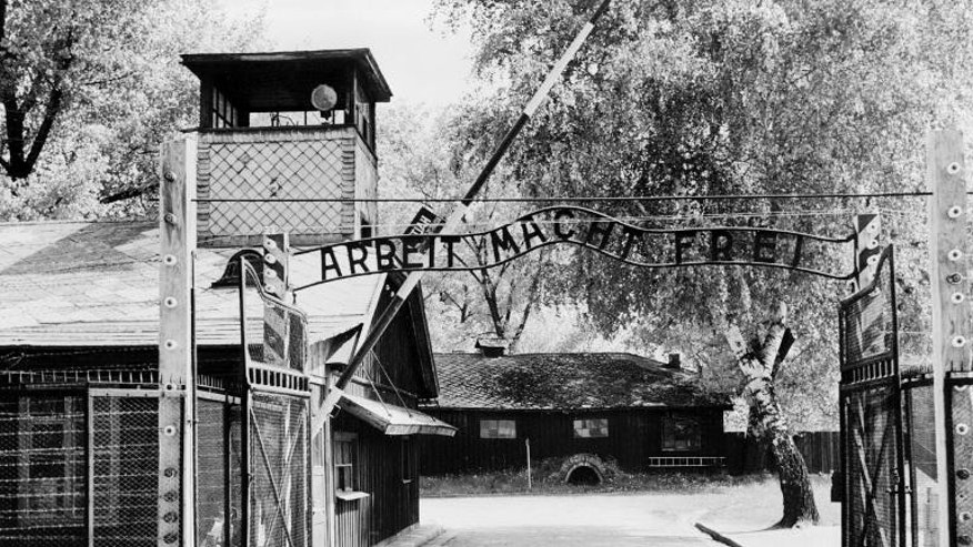 "Auschwitz concentration camp gate with the inscription ""Arbeit macht frei"", after its liberation by Soviet troops, in a photo taken on April 1945"