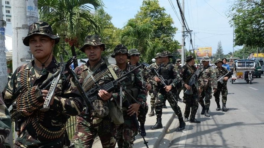 Philippine soldiers patrol in Zamboanga City, in Mindanao on September 21, 2013. Aid workers warned Thursday of a worsening humanitarian crisis in a major Philippine city wracked by more than two weeks of deadly street battles between Muslim rebels and soldiers.