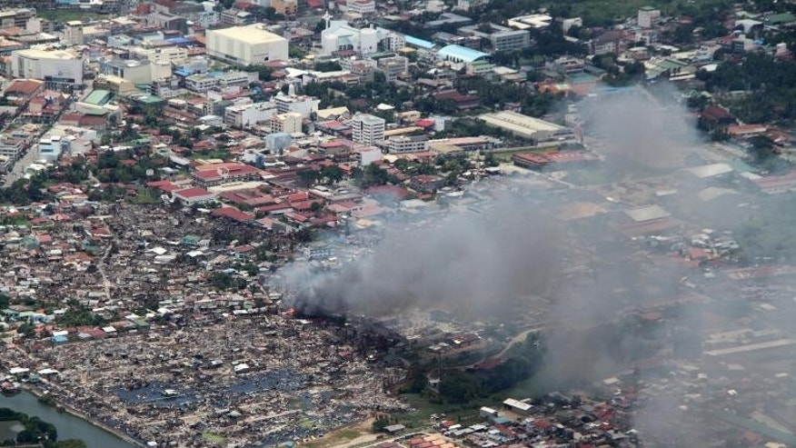 Houses burn during a firefight between government forces and Muslim rebels in Zamboanga City, on southern island of Mindanao, September 17, 2013.
