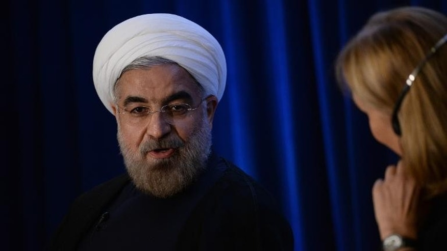 Iranian President Hassan Rouhani answers questions during an Asia Society event in New York, September 26, 2013