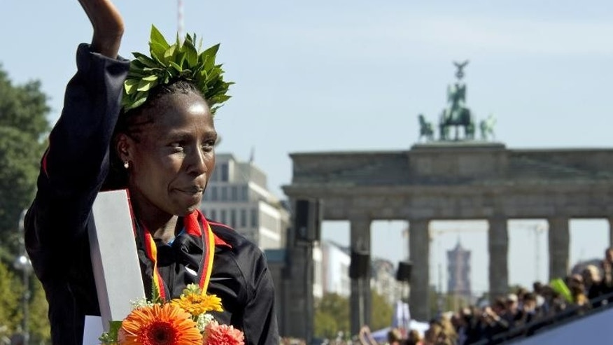Florence Kiplagat of Kenya celebrates after the 38th Berlin Marathon on September 25, 2011