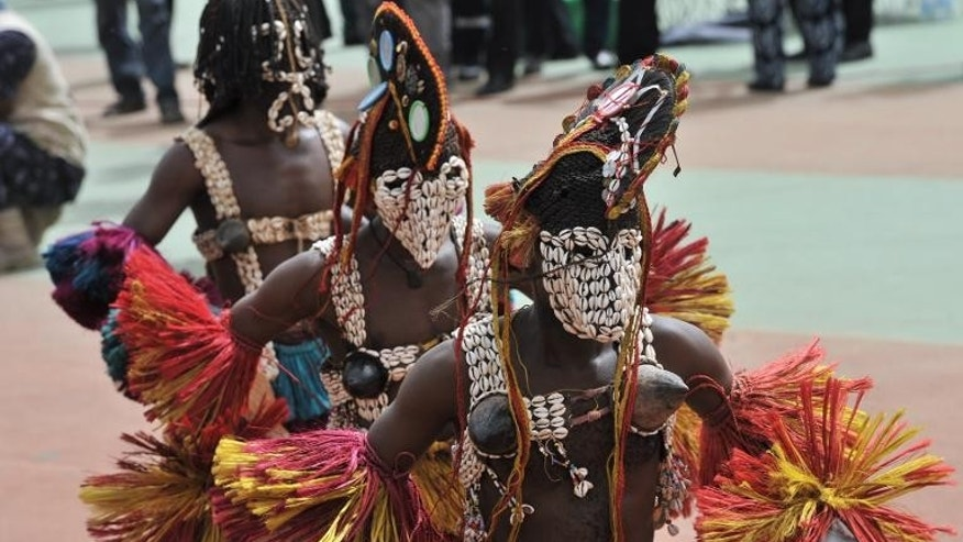 Dancers perform during the inauguration of Mali's new president, on September 19, 2013, at the March 26 stadium in Bamako.