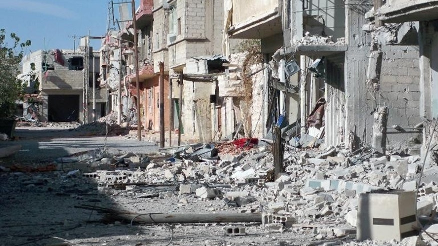 A street in the Shebaa district of Damascus, destroyed during the Syrian conflict, September 17, 2013