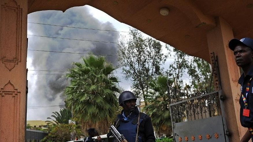 A Kenyan police officer mans the entrance of a building in the vicinity of the beseiged Westgate shopping mall in Nairobi on on September 23, 2013.