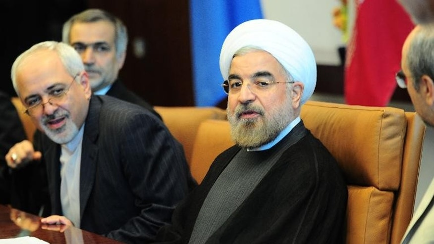 Iran's President Hassan Rouhani sits with his delegation at the UN General Assembly in New York, September 26, 2013.