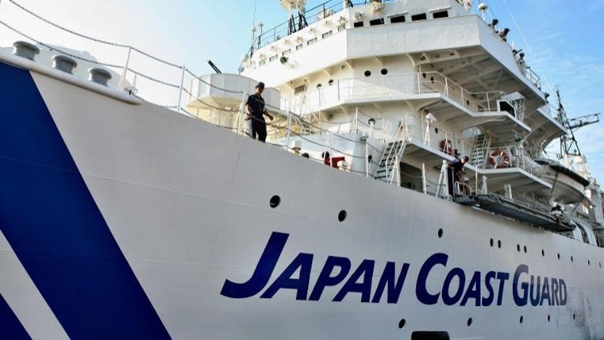 Japan's coastguard was searching Friday for six crew of a Japanese cargo ship that capsized after colliding with a Sierra Leone-registered vessel.