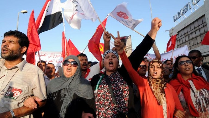 Tunisians chant slogans as they march outside the National Assembly in Tunis on September 7, 2013.